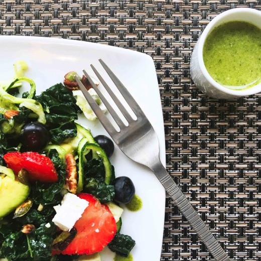 Mixed Berry and Kale Summer Salad served with a low carb mint vinaigrette.